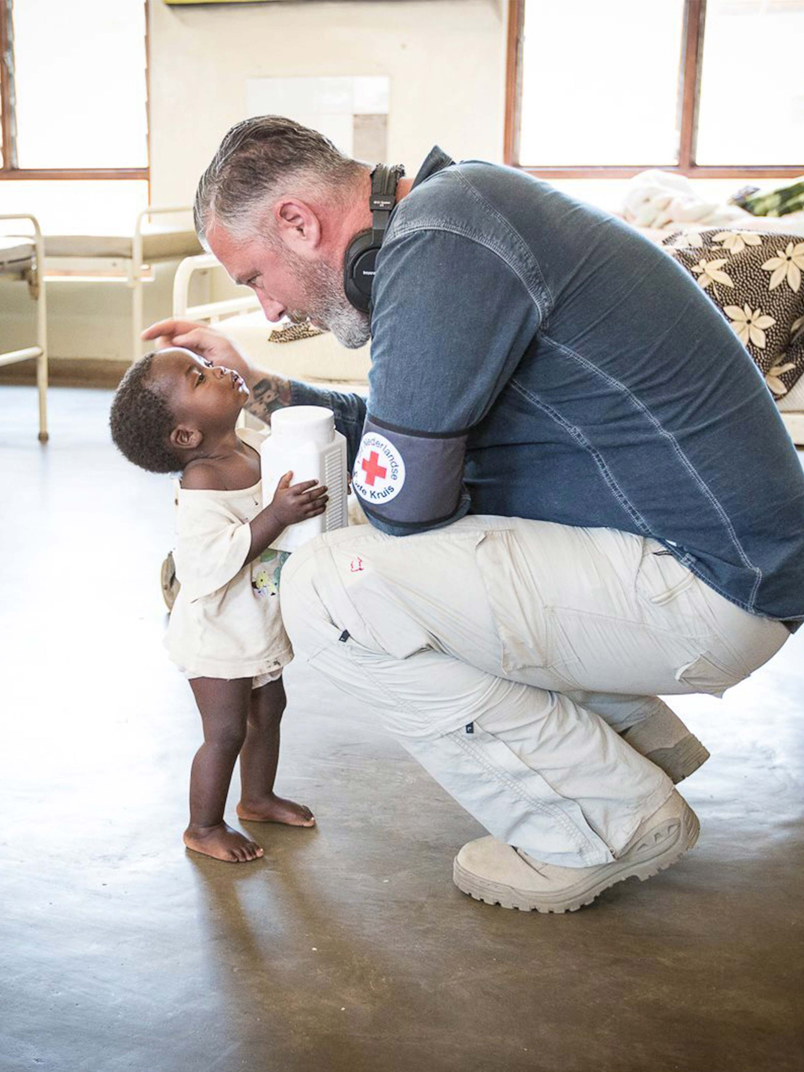 Male charity worker with young child